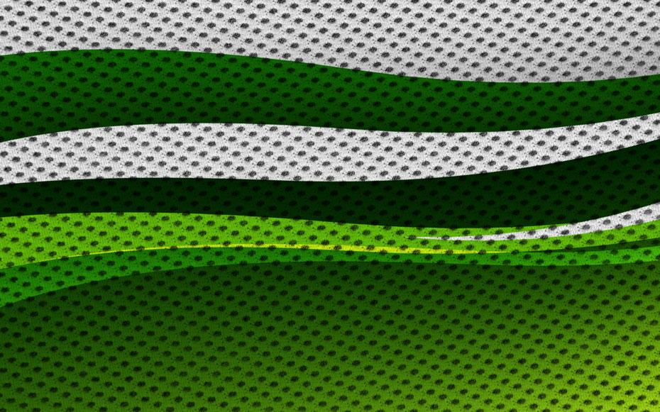 Detailansicht eines winddurchlässigen Werbebanners aus Mesh bedruckt mit grünen Flächen.